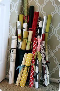 I love the idea of tying up rolls of paper with scraps of ribbon.  So pretty and it keeps them form un-rolling!