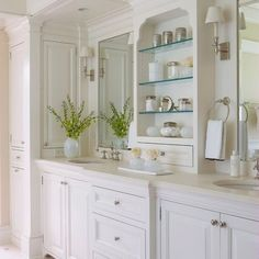 not just the all white - but placedment of center shelf and drawers . . . note side cabinet door.