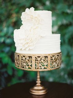 Two tier white wedding cake on gold stand| Photography: Erich McVey - erichmcvey.com