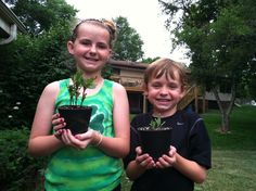 happy kids with recycled tire pots  www.flattireflowerpots.com    The kids assembled the pots themselves and learned about gardening. Such a great initiative!