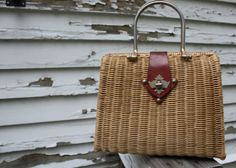would love to get a vintage wicker bag like this from Etsy.