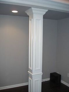hide unsightly support beams with trim