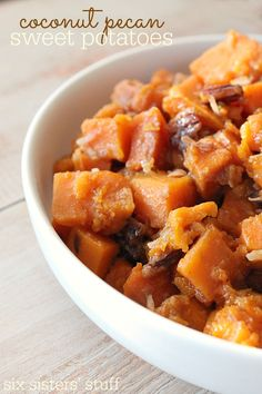 Slow Cooker Coconut Pecan Sweet Potatoes - a much healthier version of candied potatoes! I love how these make my whole house smell amazing!