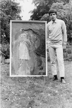 Syd Barrett with some of his artwork.
