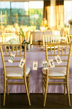 Mr & Mrs chair signs #diy #sweethearttable #weddingchicks http://www.weddingchicks.com/2014/03/24/shabby-chic-and-glam-wedding/