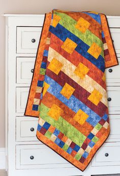 Easy strip piecing makes quick work of assembling this quilt. Leather-like prints in harvest colors give this quilt texture. Quilt kit available! Look for Pure and Simple in Easy Quilts Fall '14.