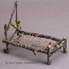 Make a twig miniature bed frame - a layer of moss makes a nice mattress    ********************************************* miniatures.about.com #garden #gardens #fairy #fairies #house #houses #miniatures #nature #DIY #accessories #crafts #twig #bed - tå√