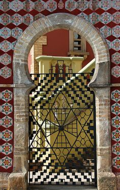 Moorish gate, seen in Comallis, Spain;  interestingly with a star of David and   a cross in the center.