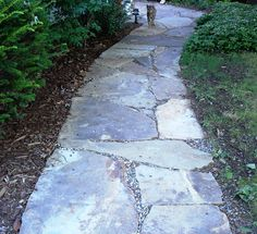 I would love to have a flagstone walkway from the driveway to the front door and from the front door to the street.