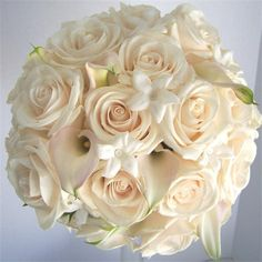 ivory roses & mini calla lilies w/stephanotis-love the idea of pink roses and the white Stephanotis especially because I think it smells good-Having some type of white nice smelling flower would make a very pleasant overall smell when we walk into the tent-