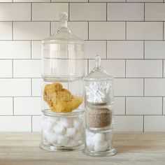 Stacked Apothecary Jars   Build up your bathroom. Stacking glass containers make a stylish space-saver and are a great way to display bath salts, soaps, sponges and more.         • Glass.    • Set of 3 stacking jars, topped with a glass lid.    • Great for smaller spaces.    • Hand wash.    • Imported.    • This item is monogrammable for an additional $7. Learn more.    $34.00 – $49.00