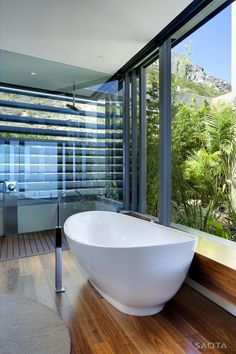 ... Tub at Head Road 1816, Fresnaye, Cape Town, South Africa. Architects: Stefan Antoni Olmesdahl Truen Architects