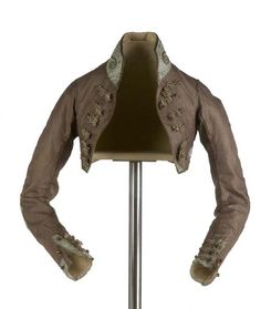 "[via google translate] ca. 1800 ""Spencer"" silk pique brown and beige. Adjusted to the torso, below the chest, high collar neckband, is decorated with an application of cord wound on silk core. The ""spencer"", also called jerkin in Spain. Museo del Traje."