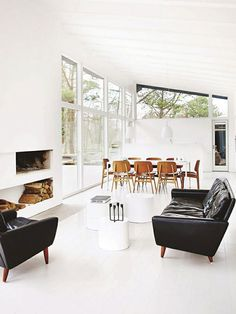 black leather sofas in a bright white room