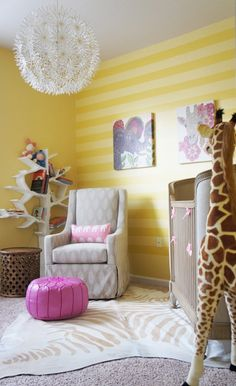 We don't have a nursery, our newborn co-sleeps with mom & dad ...but this nursery is really lovely, love the stripes wall, the bookcase, the wall art, almost everything! Sunshine Safari nursery design