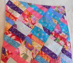If you're just learning how to make a quilt, try this Floral Scrap Quilt for Dolls. The small size makes this doll quilt easy and quick. Plus, it uses up all of your fabric scraps, so you won't have to spend money on new fabric.