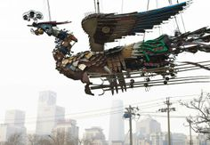 "Artist Xu Bing spent two years collecting waste material from construction sites in Beijing and forming giant 12-ton birds. Here, ""Phoenix"" soars over Shanghai in 2010 before traveling to Mass MoCA."