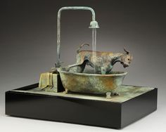 This is a #bronze #fountain, complete with a #Dane-#foot #bathtub and #Dane #soap. #Great #Danes #dogs #art #Louise #Peterson