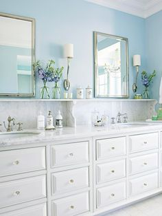 The Timeless Appeal of Marble Gleaming white marble makes a stunning style statement. For this spacious master bathroom?s double vanity, the homeowners used the upscale stone not only for the countertop, but to fashion a decorative and practical shelf above. The finished look gives a vintage nod to a 1950s hotel. I LOVE the WHITE MARBLE.
