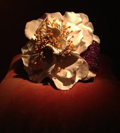 JAR  Camellia Bracelet 1995 Rubies, enamel, silver, gold. Les Arts Décoratifs, musée des Arts décoratifs, Paris   #jewelsbyjar #jarparis #joelarthurrosenthal #overmydeadrubies via sweetsabelle