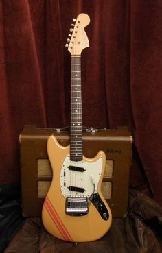 Fender Mustang in competition orange.