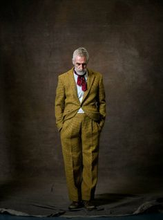 Scottish playwright and artist John Byrne in a soft mustard Harris Tweed suit.