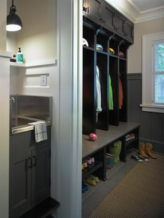 Stainless sink with built in stepstool ~ cubbies, cupboards & wainscotting ~ Linden Hills Cottage Kitchen -Custom Home Magazine