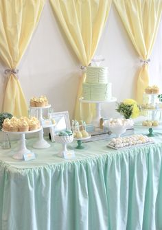 Pretty yellow and blue dessert table by One Lovely Day.