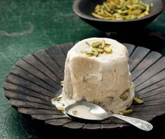 Cardamom & Pistachio Nut Kulfi Recipe | from John Gregory-Smith's Mighty Spice Cookbook | House & Home-1-3/4 cups evaporated milk  1 tbsp cornstarch  1/4 cup sugar  3 cardamom pods  Scant 1/4 cup unsalted pistachio nuts, sliced, plus extra to serve  Scant 1/2 cup heavy cream