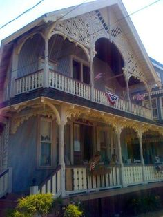 Ornate victorian with two level porch.