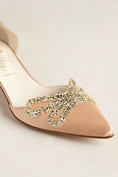 blush satin kitten heels with a glitter bow. perfect shoes for a bride.
