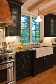stove, exposed beams, farms, black cabinets, kitchen, farmhouse sinks, farm sinks, farmhous sink, wood beams