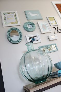 Gallery Wall...I like the idea of mixing pieces so it's not all pictures! I want to paint all the frames in the staircase just one or two colors!!!!