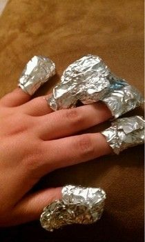 How to remove Acyrlic nails easier. Put acetone on a cotton ball, put the cotton ball on top of the nail and then wrap with foil. Just let it set for a couple minutes and wah-la!