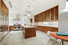 The kitchen features heirloom cabinetry with antique glass and nickel-plated hardware.