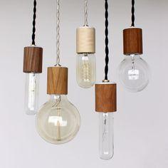 Wood veneered pendant light with bulb via Etsy.