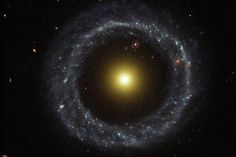 "Hoag's Object. A ring galaxy in which there is a central core of older yellow stars with a ring of young blue stars. The formation of a galaxy like this probably involves a galactic collision. Look through the gap at one o'clock to see another ring galaxy in the distance. (Credit: R. Lucas (STScI/AURA), Hubble Heritage Team, NASA) Mona Evans, ""Galactic Winter Games"" http://www.bellaonline.com/articles/art182620.asp"