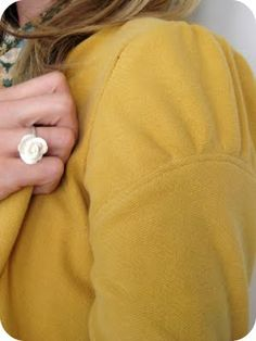 Very short tutorial on making a blazer from a men's sweatshirt. I need more time to sew. love this sleeve detail. it would look amazing in a sweater, too.