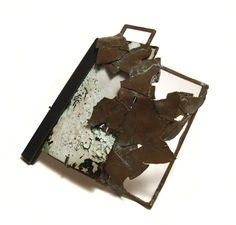 Kirsty Sumerling; Unkempt brooch, white precious metal, copper, enamel.