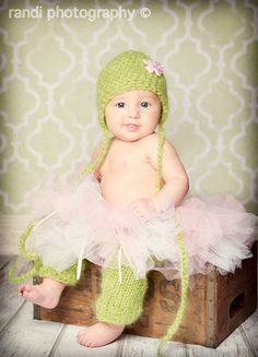 So cute!  The etsy seller is here: http://www.etsy.com/listing/74631159/knit-baby-hat-and-baby-legwarmers-set-in