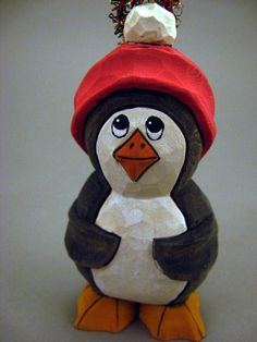Hand Carved Wood Penguin Christmas Ornament. $20.00, via Etsy.