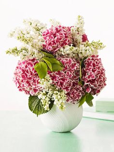 Hydrangeas, with their subtle scent, make an ideal partner for lilacs, which give off a heady perfume.
