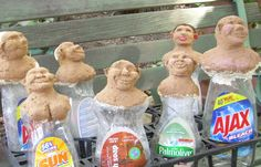 Recycle Art- paper mache dolls using empty dish soap bottles.