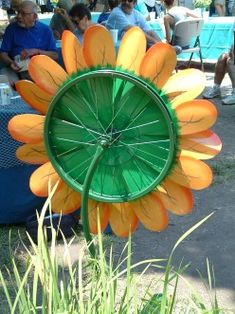 Back of spinner flower showing recycled bicycle wheel which has been painted to look attractive no matter what angle the flower is viewed.