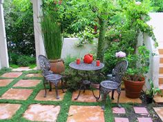 Thyme grows between the pavers in this courtyard designed by Joan Grabel.