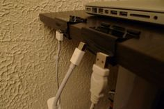 binder clips with the addition of magnets to keep his cables affixed to a desk