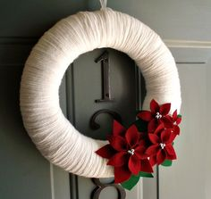 Yarn Wreath Felt Handmade Holiday Decoration - Poinsettia 12in. $40.00, via Etsy.