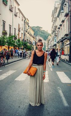 Basic black tank, maxi skirt, oversized clutch, bangles and top not bum.    Easy vacation outfit