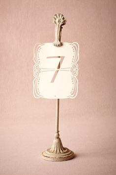 Distressed pedestal clip from BHLDN for your table numbers