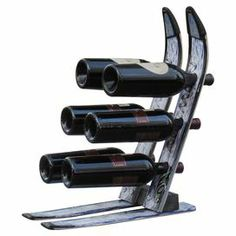 """Tabletop 6-bottle wine rack crafted from reclaimed skis. Handmade in the USA.  Product: Wine rackConstruction Material: Reclaimed stainless steelColor: MultiFeatures:  Made from used, slightly weathered skisBottles are stored on their sides to properly maintain the wine's integrityWeather-resistantHolds six bottles Dimensions: 18"""" H x 11"""" W x 16"""" DNote: Due to the re-purposed construction of this product, color and size may vary from what is pictured"""